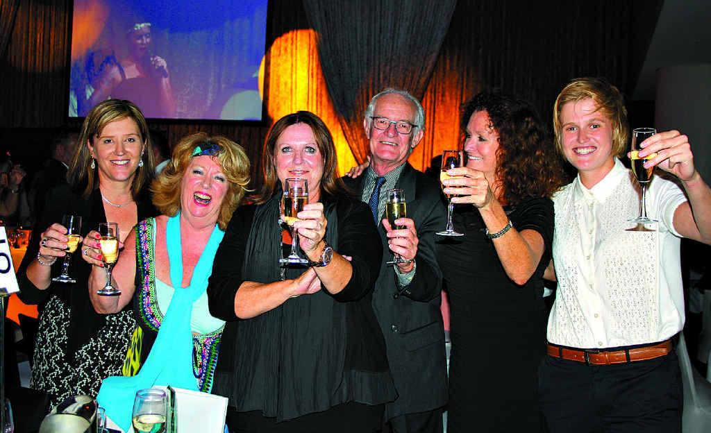 CELEBRATING: Laguna Real Estate's Kellie Drinnan, left, Leona Heeley, principal Olivier Miller, Roger Omdahl, Melanie Butcher and Rhiannon Butcher celebrate being named 2013 REIQ Large Residential Agency of the Year at Brisbane Hilton. Photo: Erle Levey