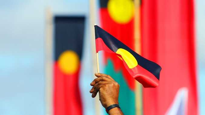 ROK-march09c Aboriginal flags fly during the Naidoc Week march through Rockhampton CHRIS ISON CI09-0710-5