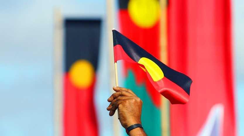 ROK-march09c Aboriginal flags fly during the Naidoc Week march through Rockhampton CHRIS ISON CI09-0710-5