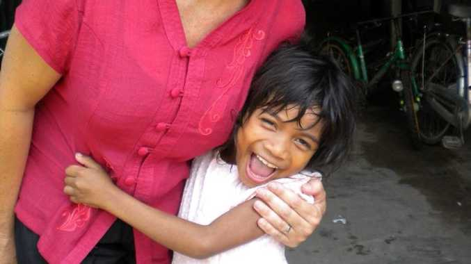 Jenny Christie with one of the Kindy kids from New Hope Cambodia. Photo: Contributed