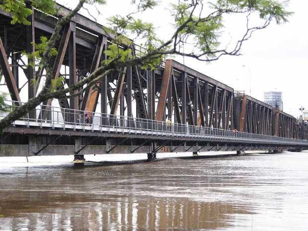 Floodwater runs high under the Grafton Bridge. Photo: JoJo Newby