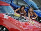 Kirsten Fuller and Maderson Whittaker wash Steve Lewis's cars ahead of this weekend's Rhythm and Revs.