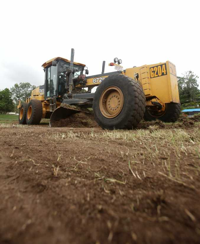A grader takes the grass off of Rugby Park in preperation for levelling and turfing. Photo Allan Reinikka / The Morning Bulletin