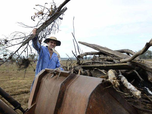 Armidale university student Tom Granleese clears flood debris from Clarendon Farm near Ulmarra.