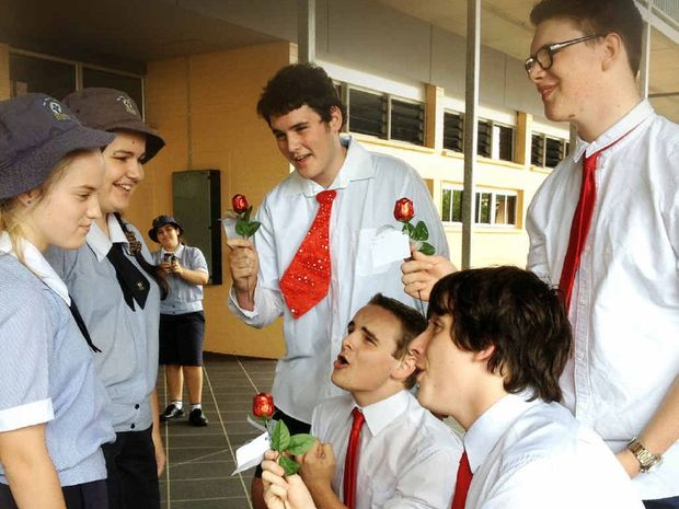 St Patrick's Year 9 students Ella Moro and Belarna Pertot are serenaded by Valentine's Day quartet Liam Mills, Patrick Connolly, Andrew Los and Jackson Plate.