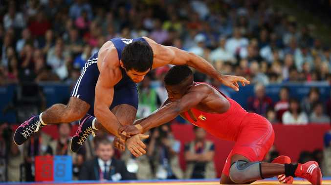 Livan Lopez Azcuy of Cuba in action against Jabrayil Hasanov of Azerbaijan during the Men's Freestyle 66 kg Wrestling bronze medal fight on Day 16 of the London 2012 Olympic Games.