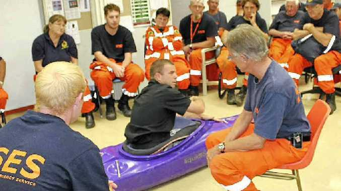 KAYAK RESCUE: Trainer Phil Benfield passes on some tips on handling a kayak to rescue volunteers from police, SES, ambulance, helicopter and road accident crews.