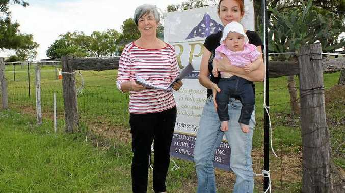 N B Beggs Pty Ltd owners Barbara and Nicola Beggs, with baby Bridgit, at the site on the corner of Bracker and Homestead Rds they plan to develop into a childcare centre and convenience complex.