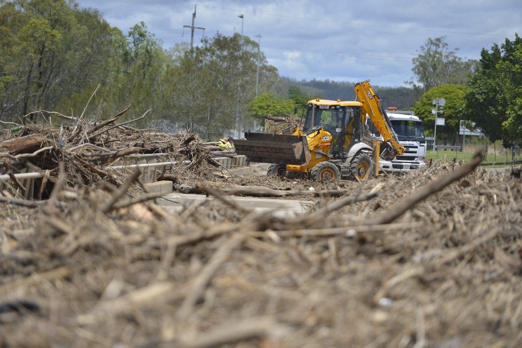 Debris left on the South Tree's Inlet bridge in Boyne Island is cleared.