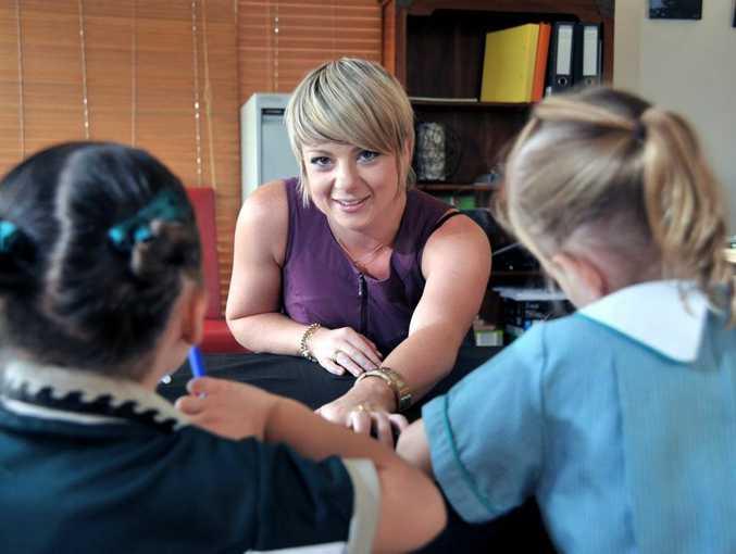 Psychologist Natasha Hutchison working with children at Spectrum Psychology.