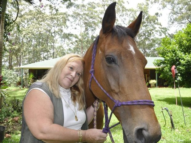 Cabarlah resident Tami Mills hopes her horse Betty will not contract Hendra virus from a recent influx of flying foxes.