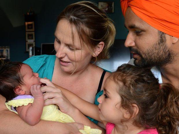 Mum Melissa Cattell, Dad Aman Deep Singh, Baby Sophia Preet Singh and Big sister Hamelia Joy Manjit Cattell.