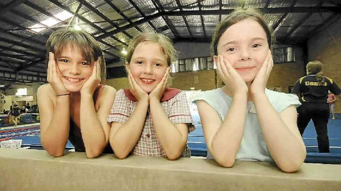 BEAMING GYMNASTS: North Coast Gymnastics club members, from left, Sera-fina Johnston and Tamsyn Phipps, of Goonellabah, and Monica Brine of Lismore.