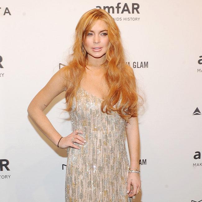 Lindsay Lohan at the amfAR Gala.