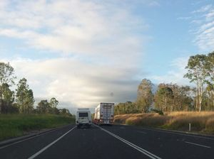 B-double overtakes car on double white lines on Bruce Hwy