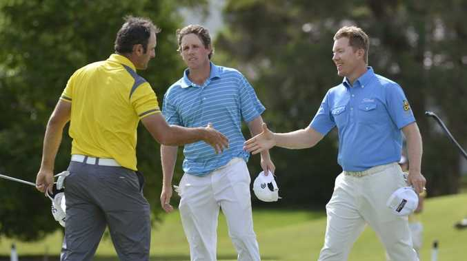 Brad Kennedy (right) is congratulated by runner-up Michael Hendry (left) and David McKendrick after winning the Queensland PGA Championship at Toowoomba's City Golf Club.