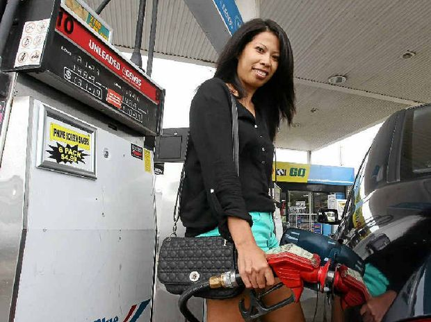 UNDER THE PUMP: Sokunna Son from Mountain Creek fills up her car with petrol. She would struggle to cope if the price of petrol kept rising.