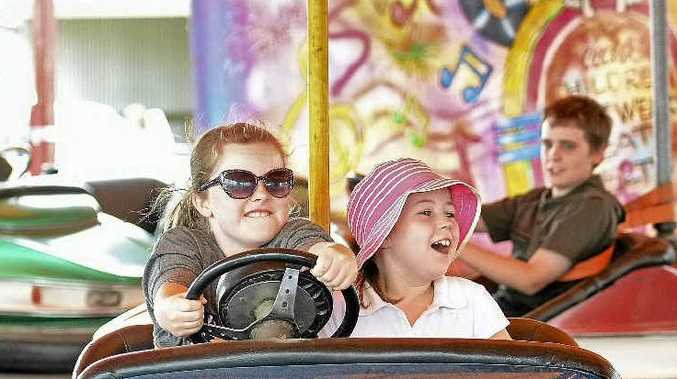 SIDESHOW ALLEY: Caitlin Fogarty and Lilly Ferguson from Clifton enjoy the dodgem cars in sideshow alley.