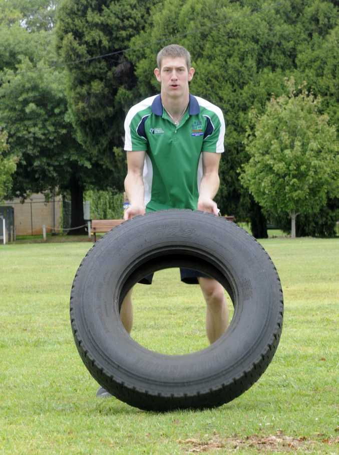 Simon Verlaat flips a tyre as part of his Tough Mudder training.