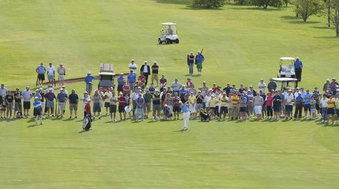 The final Queensland PGA Championship group makes its way down the 18th fairway at City Golf Club yesterday.