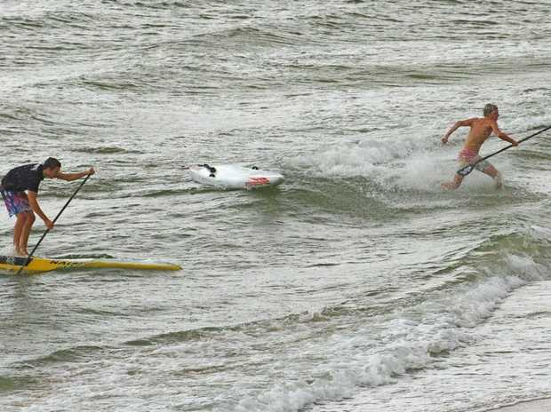 Lincoln Dews competing in a stand-up paddling event.