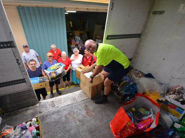 Gympie's John Sanderson unloads the care packages made and donated to Bundaberg flood victims by Gympie patchworkers.