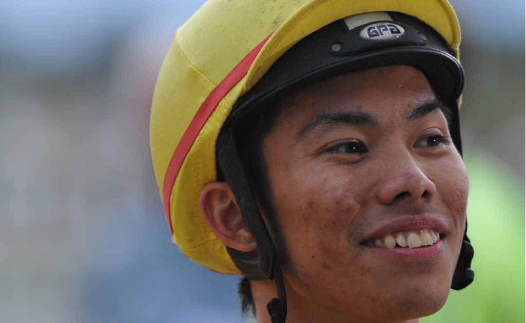 Jockey Allan Chau is all smiles after winning a race at Grafton in 2011. Photo: JoJo Newby