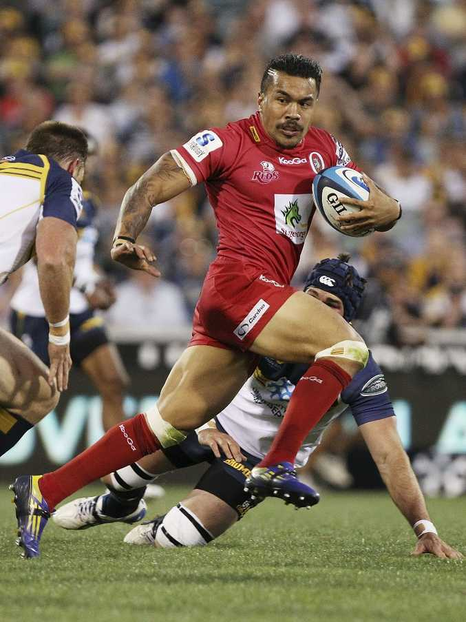Digby Ioane of the Reds runs the ball during the round 1 Super Rugby match between the Brumbies and the Reds at Canberra Stadium on February 16, 2013 in Canberra, Australia.