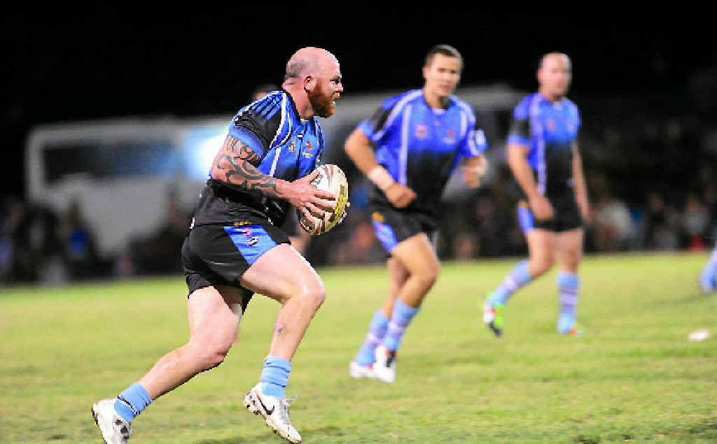 Rockhampton's Todd Titmus steels himself to take on the Calliope defence.