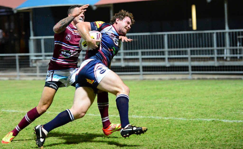 TRY TIME: Capras' Brent Williams shrugs off the tackle of the Cutters' Jordon Grayston and charges for the tryline in the Intrust Super Cup trial match at Browne Park.