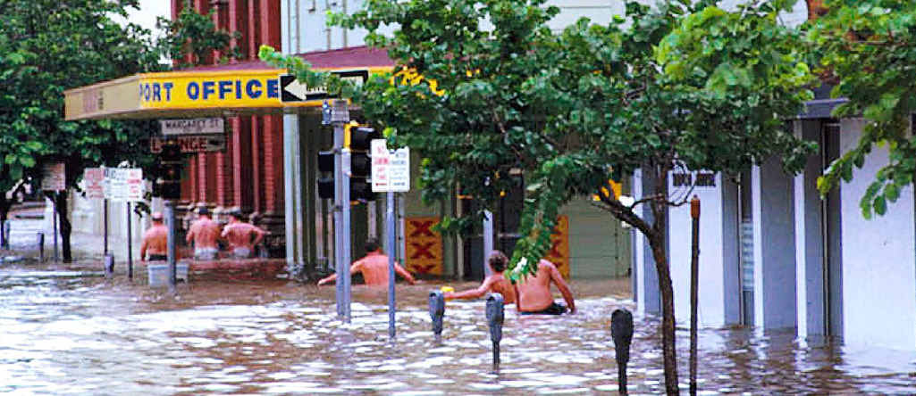 CBD AWASH: Edward St in Brisbane's CBD is flooded in 1974.