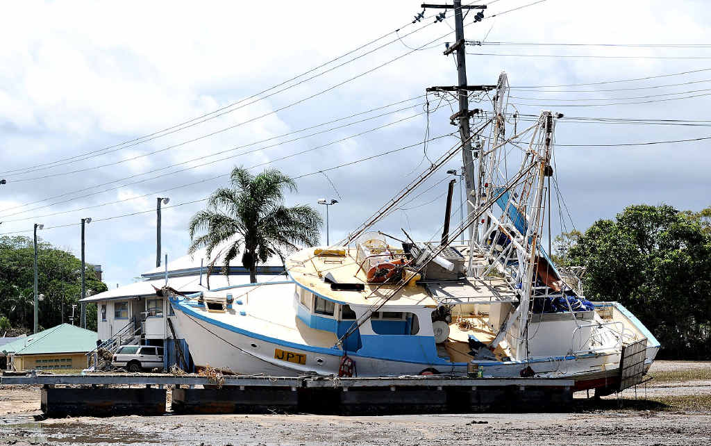 UNSTOPPABLE: The Burnett River hit Bundaberg at a fierce 70kmh, devastating all in its path and leaving this fishing trawler high and dry.