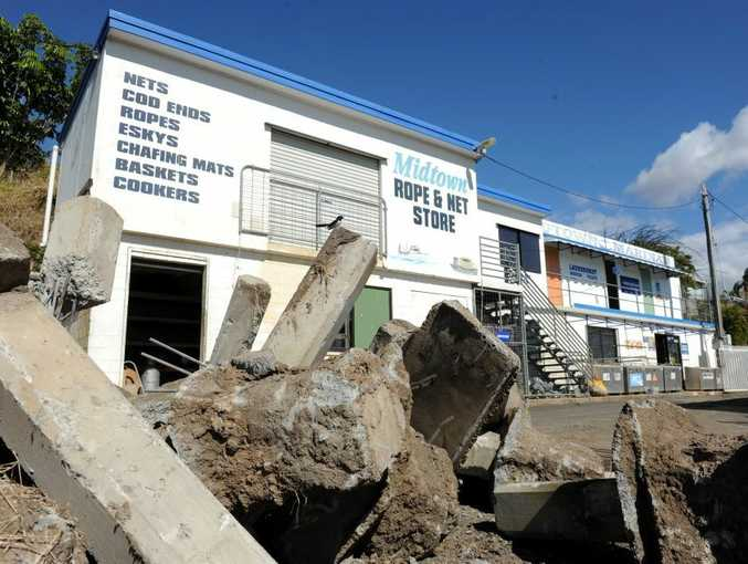 The building belonging to Midtown Marina was in a precarious position before the riverbank collapsed last night.