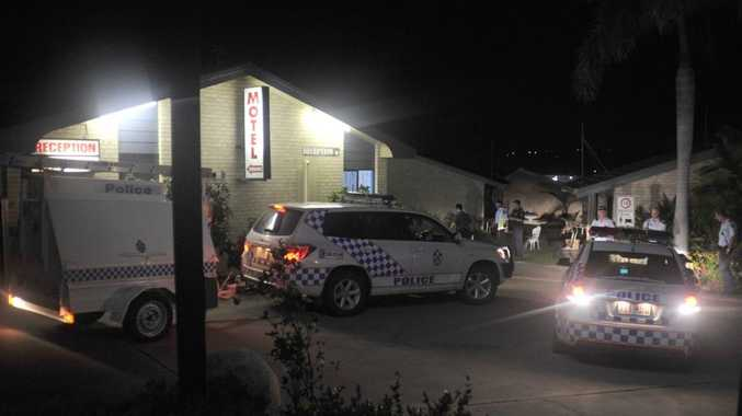 Police investigate the crime scene where a sex worker was allegedly murdered in Gladstone.