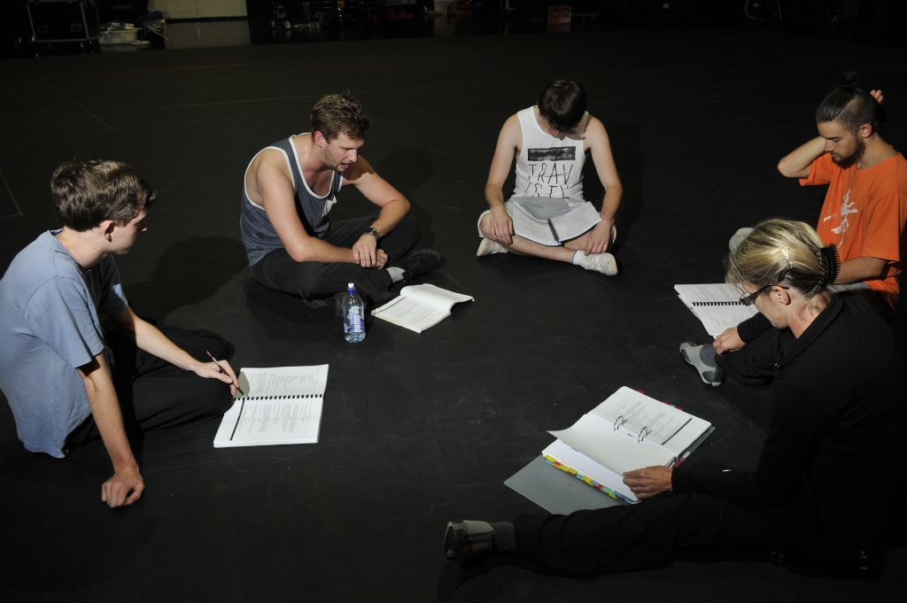 Director Alison Vallette with Ryan Paroz, Zack Weedon, Matt Collins and Gabe Comerford (choreographer) review the script for the Empire's production of Hairspray.