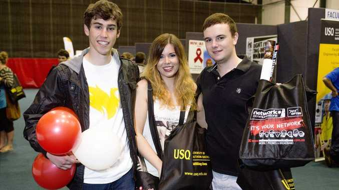 Leaving Market Day 2013 with a bunch of free swag are students (from left) Alex Cossu, Kirsty Sankey and Sam Volker.