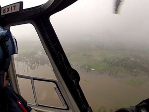AGL Action Rescue Helicopter fly to aid of sick woman trapped by floodwaters