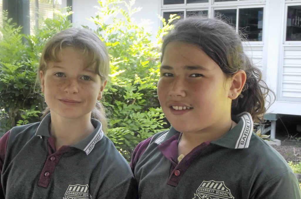 Kaitlin Burns and Takiah Moore-Barrett and other children from Gargett State School will help with celebrations for the school's special milestone next year.