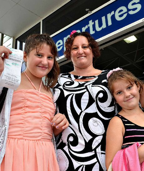 Donna Olsen and two of her daughters, Brittney left, and Abby where thrilled to be Tiger Airways 10 millionth passengers.