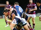 Tone Susuga fights off the Capras players. Capras vs Mackay Cutters. Trial game at Browne Park. Photo Sharyn O'Neill / The Morning Bulletin