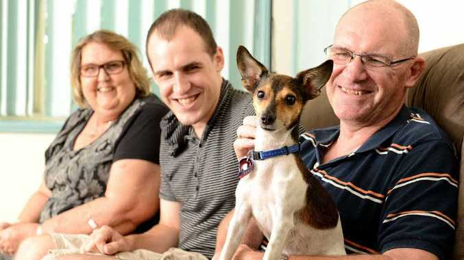 Bev and Tom Brisbane with their son Matt and their new dog Bosco the fox terrier cross they adopted from the RSPCA.
