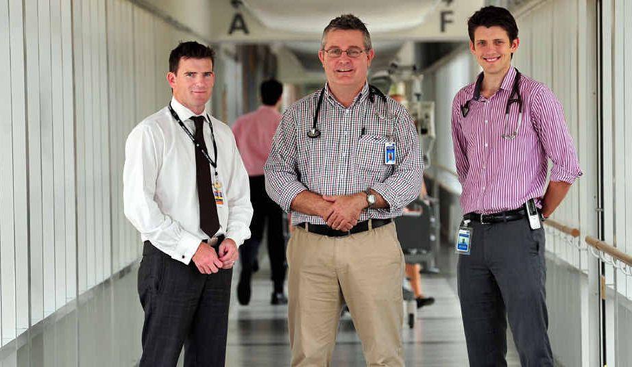 SCRUBBED UP: Noosa Hospital CEO Oli Steele with Doctors Simon Hawkins and Paul Jauncey.
