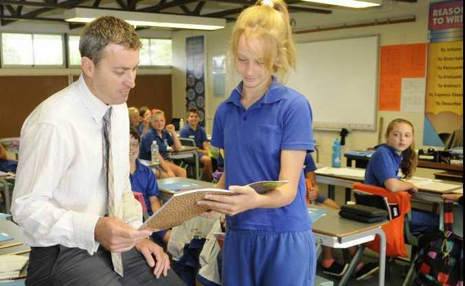 Wilsonton State School Principal Richard Gibson talks with year seven student Taylar Gillis.