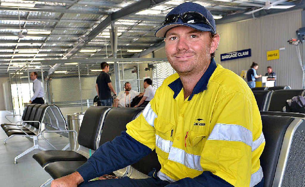Mine worker Matt Farrell is eager to get on his flight to Bundaberg.
