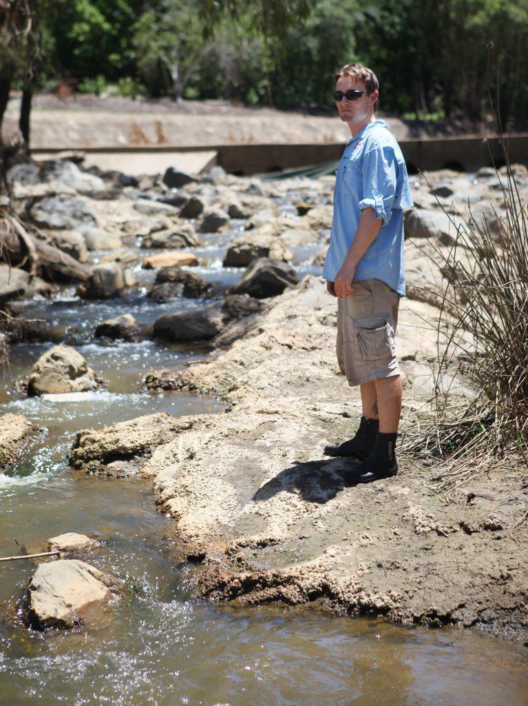 Fisheries biologist Matt Moore at the fish ladder in Moores Creek. Photo Allan Reinikka / The Morning Bulletin
