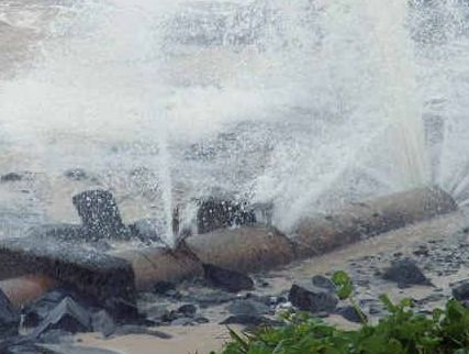 SMASHED: Broken pipes at Shelly Beach as a result of the stormy seas.