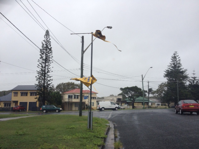 Wild weather conditions caused signs to rip at Yamba.