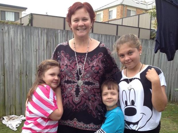 Elizabeth Davies, with her children Holly, Caleb and Annika, says praise should be genuine.