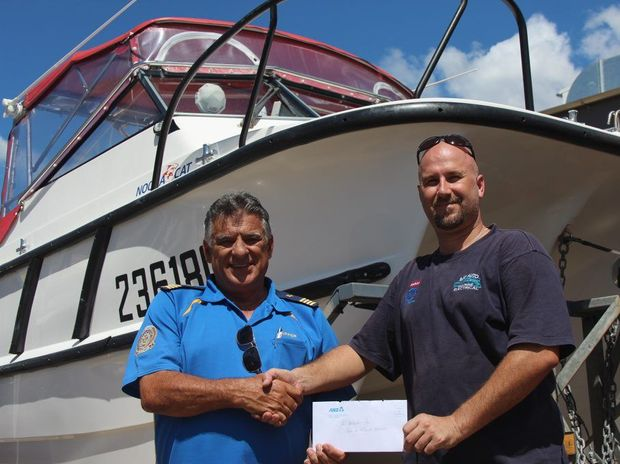 Volunteer Marine Rescue Hervey Bay Commodore Tom Hudson with new owner Peter Mueller.