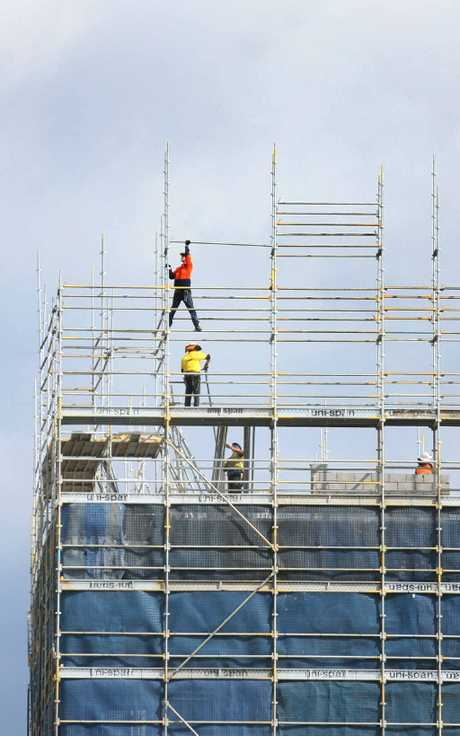 Tradesmen work on the Quest Apartments on Victoria Parade, one of several developments contributing to a huge boost in accommodation in the region.